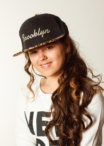 Jodie wearing baseball cap