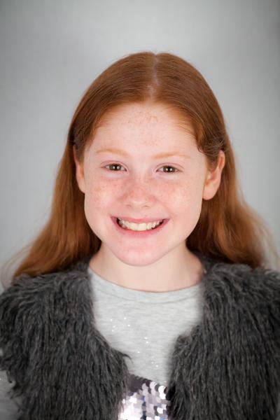 Lara smiling with teeth
