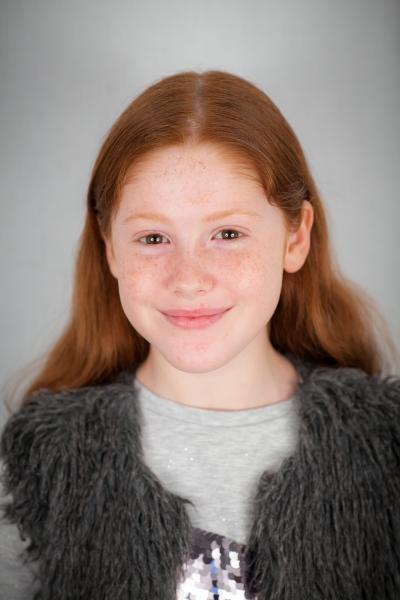 Lara smiling without teeth